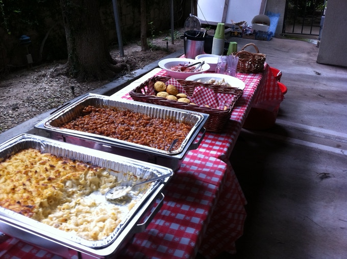 Catered event (up to 50 people) with 2 of our staff.