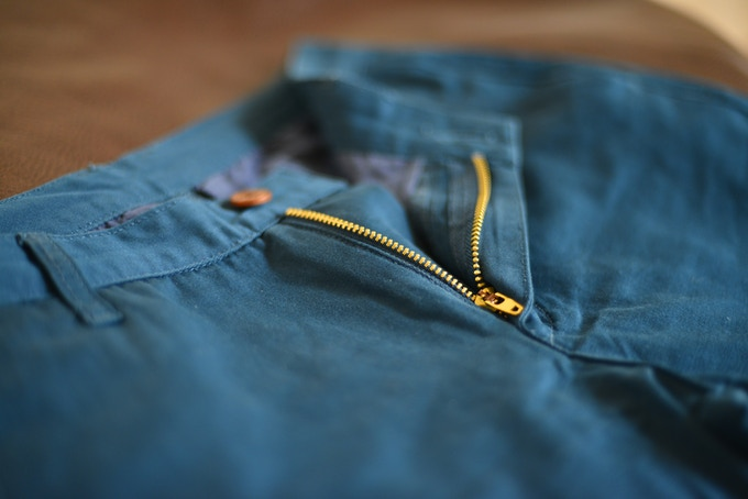 The signature Gold Zipper of the Finn Hem Trouser