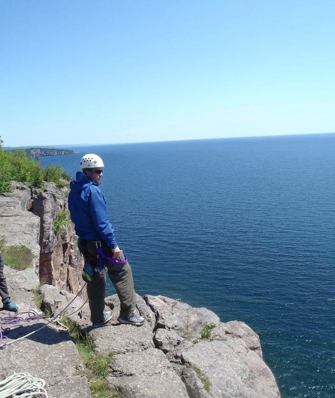 Looking out over Lake Superior during a rock climbing anchor building workshop