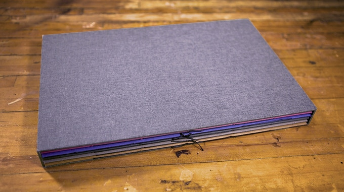 The hand-bound slipcase will have a custom de-bossed logo on the front.