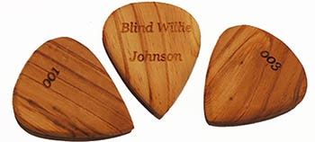 Each handmade engraved and numbered souvenir pick is unique reflecting the grain and the veins of the wood and other natural imperfections.