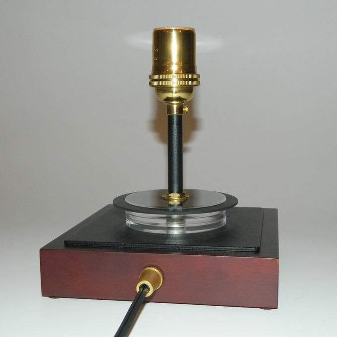 Metal + wood base w/ brass cord grip and socket