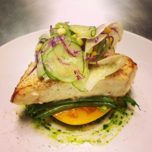 Pan roasted halibut, on an heirloom tomato steak,  parsley puree,  french beans,  and a summer vegetable slaw