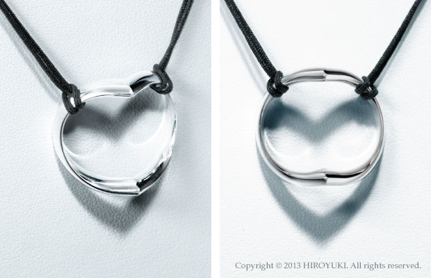 The Shadow Heart Necklace made of sterling silver. (Silk string)
