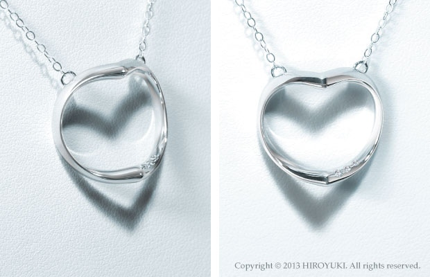 The Shadow Heart Necklace Diamond Edition.  The pendant is made with platinum and includes three inlaid diamonds. (White gold chain)