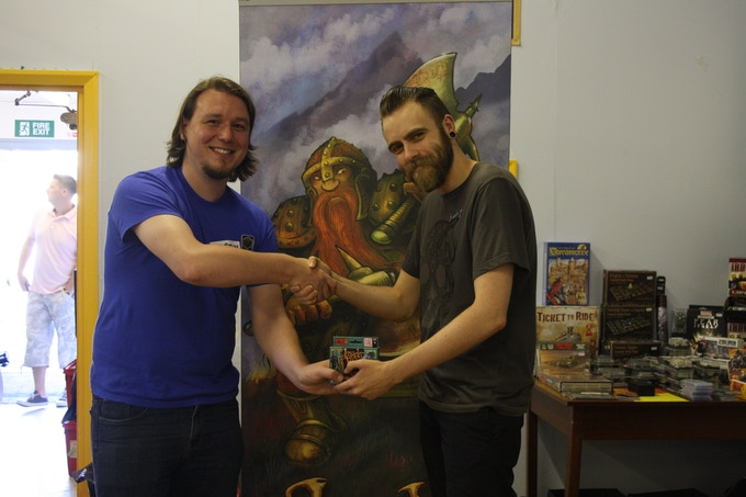 Martin shaking hands with Olly James, winner of a free Lords of War: Elves versus Lizardmen pack at the first-ever Lords of War Tournament in Brighton, organised by UK gaming club Gambit Games and local retailer Kids Dreams.