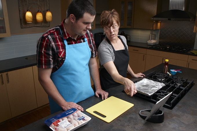 Forrest and Sue making chicken using Look, Cook, and Eat.