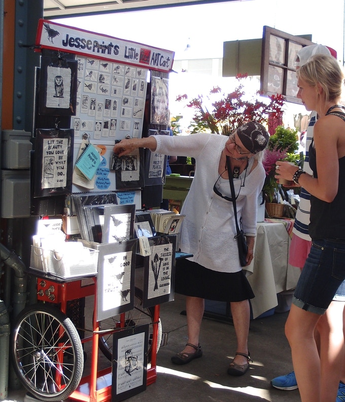 I am a car-free artist and vendor.  This is me at a summer farmers' market .