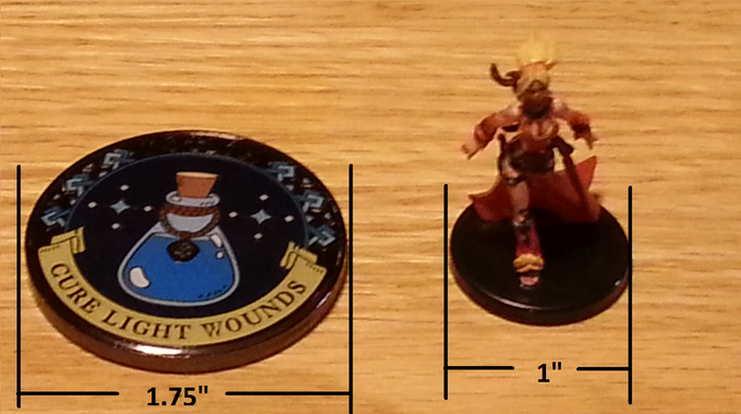 """To give a good idea of how big that actually is, here is a pic of the actual size of the finished product next to a medium sized RPG miniature. (The coin pictured is an actual finished """"Cure Light Wounds"""" Potion Token)"""