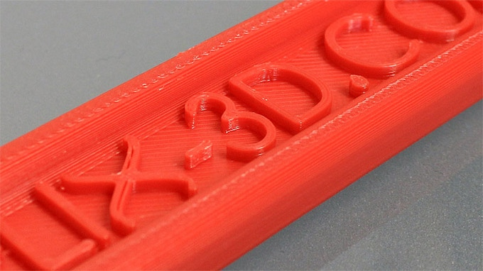 Wrench handle layer detail in red ABS.  Printed at approx. 200% scale on Helix.