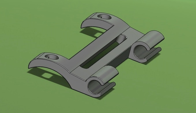 For now, you'll have to imagine the joy of mounting this under your water bottle cage, and snapping your UpStand into place. Awesome green background not included.