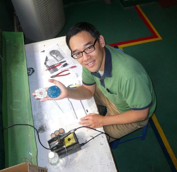 Reviewing PCB's at our manufacturing partner in China