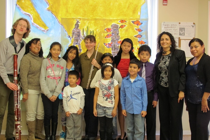DSE artists with Casa Monarca leadership and children after performance/presentation, October 2013