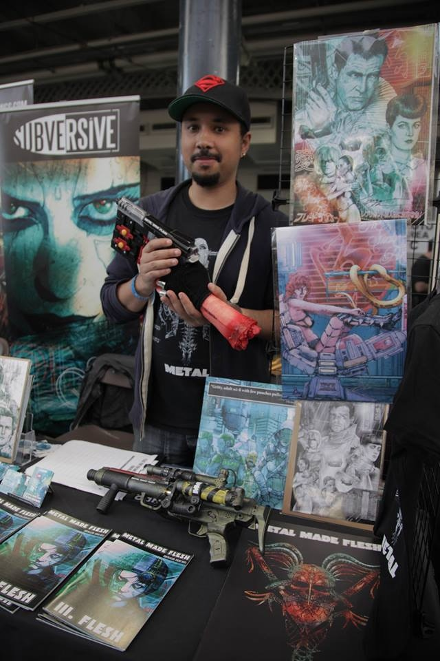 Simeon Aston with assorted artwork at London Film and Comic Con (Including home made prop gun)