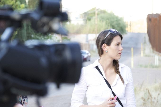 Director Hilary Linder filming at the Arizona-Mexico border in June 2013.