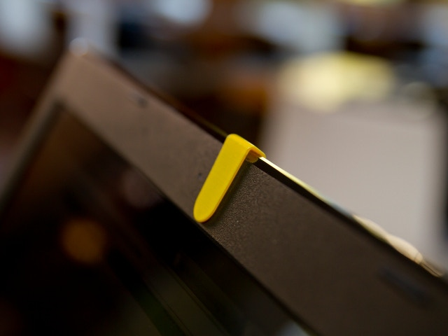 Front view of a yellow TAPATUCAM clip