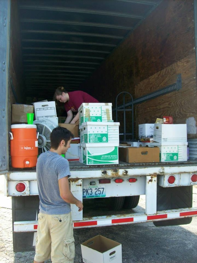 Volunteers helping to move thousands and thousands of books