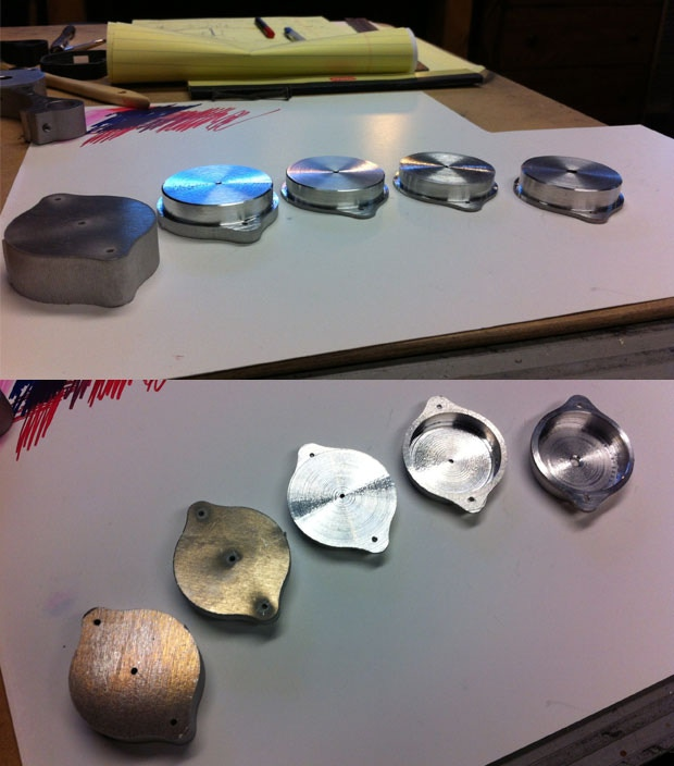 Motor caps for the DB-1 in various stages of production.