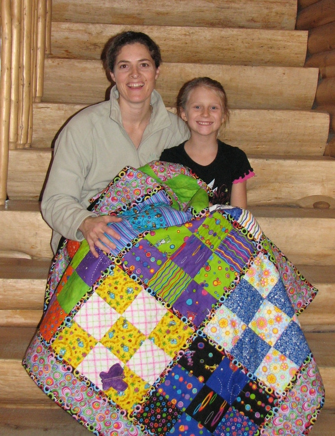 Brandy & Kristy in November 2009 with Kristy's first quilt
