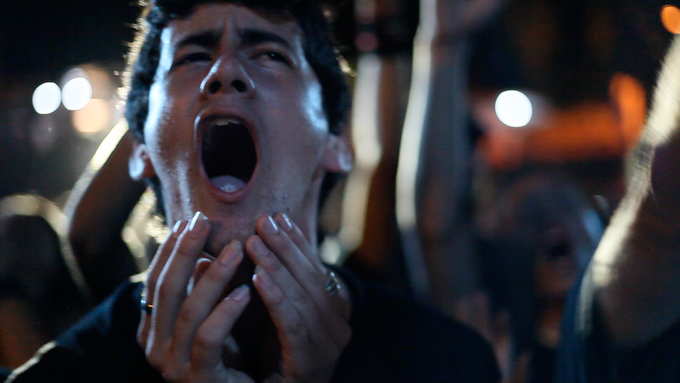 One of Zeus's fans shouts along with Diony during an outdoor concert in Havana