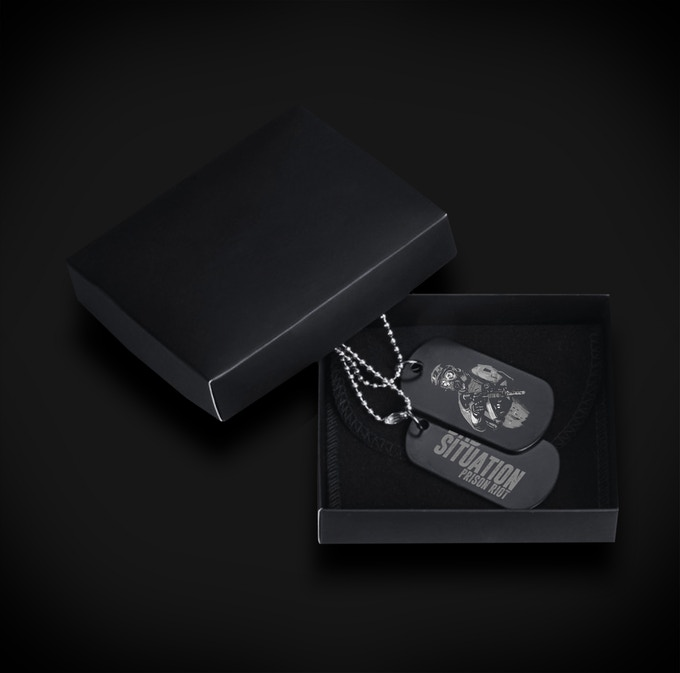 Themed black military dog tags. Receive when you pledge $99 or more