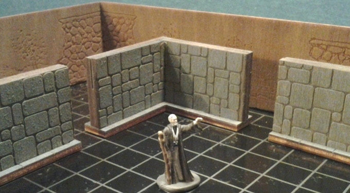 A wizard stands in front of some of our stone wall add-ons Inside the Fantasy Box Option. (Miniature NOT included).