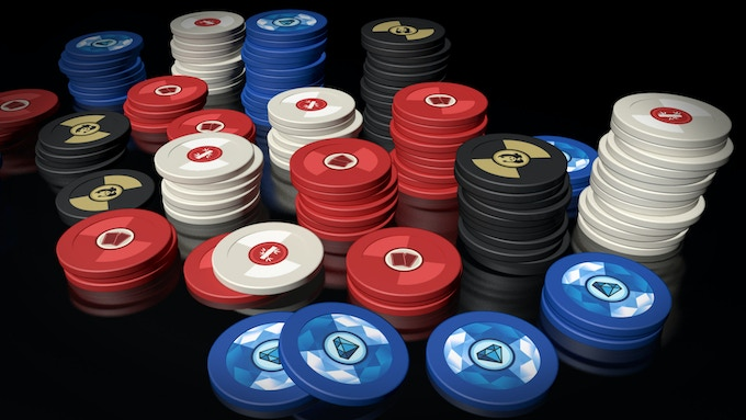 Clay poker chips in the deluxe version of Pandante.