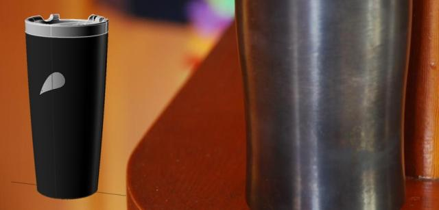 this photo shows the black oxide coating on a prototype mug; in the inset a computer-generated rendering of the complete mug is shown