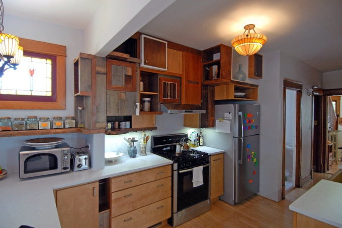 incidental kitchen-pieced together out of scraps and cabinets from other kitchens