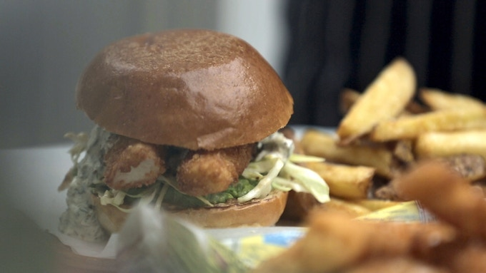 Fish finger sandwich - pea puree, maddy's slaw and tartare sauce, breaded fish fingers in brioche bun
