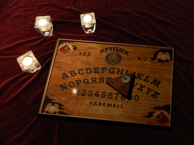 """Let the spirit move you with this fine, hand-crafted Sphinx spirit board (21"""" x 15 ¾"""")."""