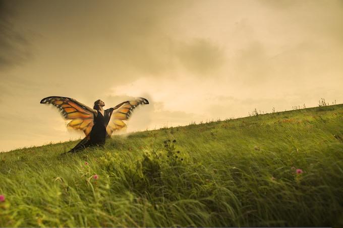 """After Metamorphosis"" Gwynedd Vetter-Drusch (Director and dancer) on the Konza Prairie in Manhattan, KS. Photo by Gabriella Garcia-Pardo for Moving for Monarchs"