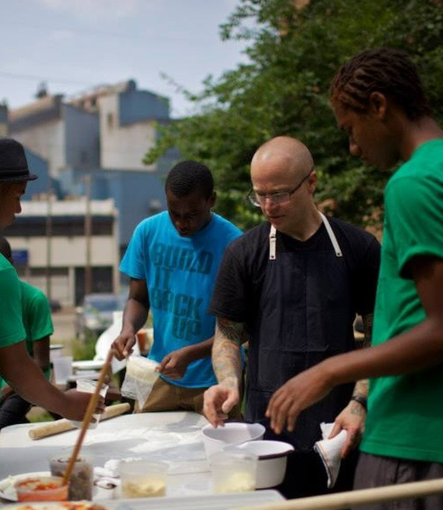 Chef Sousa, Braddock Youth Project training class at the community bread oven