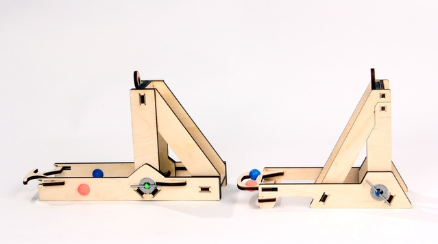 The original catapult on the left, and the new catapult on the right.