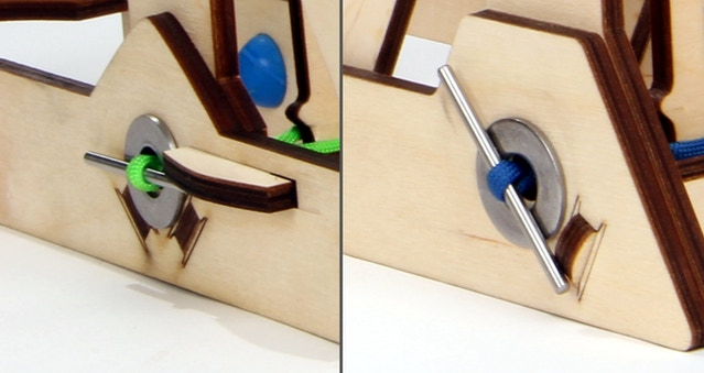 """Left: old twist bar stopper, with slider. Right: new twist bar """"speed bump"""" stopper."""
