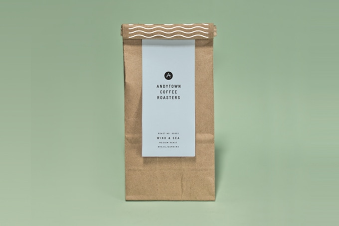 Our coffee bean packaging is a love letter to the Sunset. Waves crawl up the back of the bag, peeking over the top.