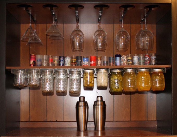 Improve your bar (in both style and function) by hanging your homemade condiments, infused drinks and mason jar cups