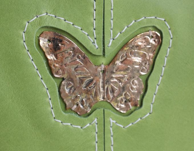 Butterfly on Grassy Green