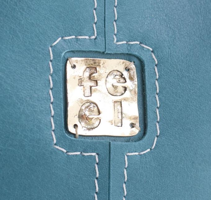 FEEL logo on Aqua