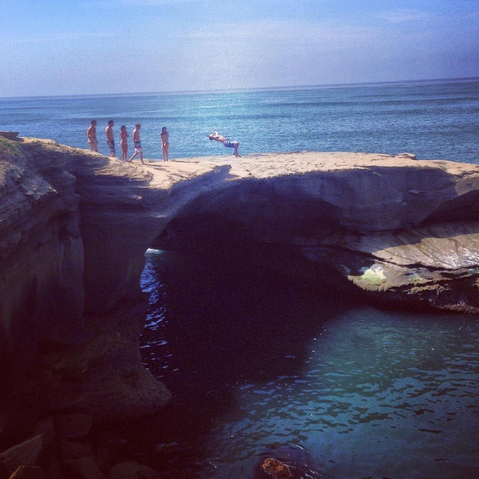 Founder Nathan Resnick and friends cliff jumping