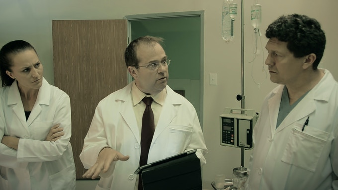 Eric Edwards as Professor Lamb (flanked by Kristin Goddard & Michael Miraula)