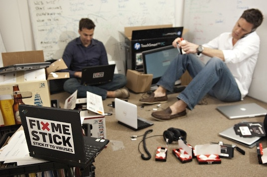 Corey and Marty bootstrapping the FixMeStick circa 2011.