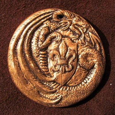 """Fleur-de-lis with a crescent dragon (front), measures 2 3/8"""" in diameter"""