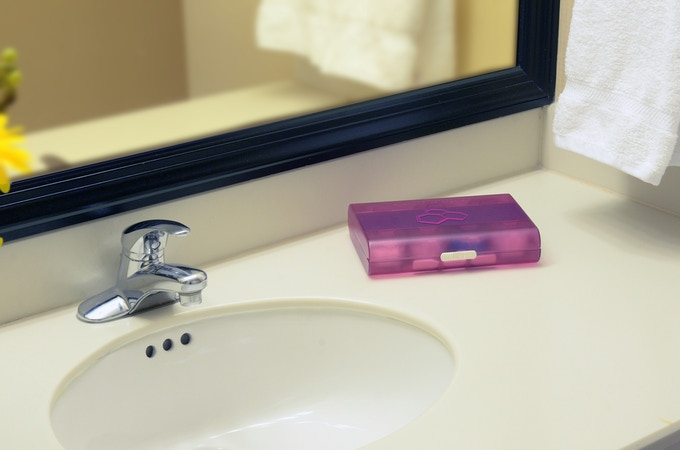 Bathroom counter organized and uncluttered.
