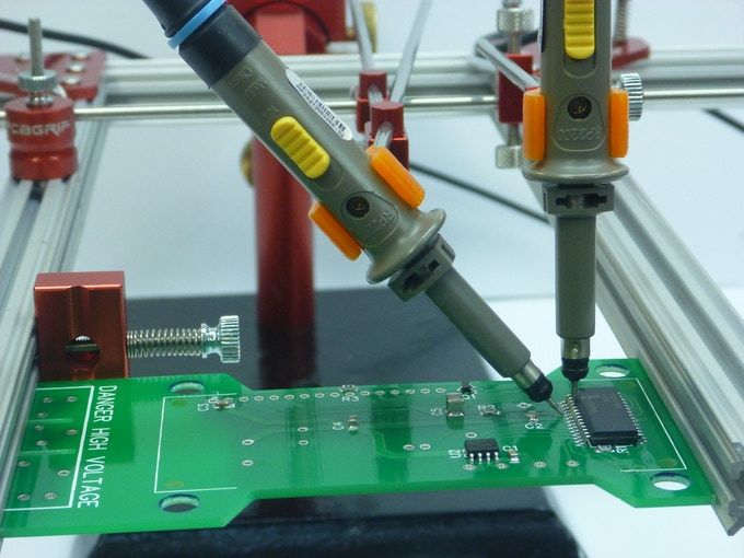 3D printed oscilloscope clamps being used with PCBGRIP to hold probes.  Click-through for 3D model.
