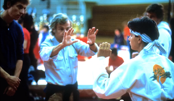 "John G. Avildsen preparing a shot with Ralph Macchio on the set of ""The Karate Kid"" (1984)"