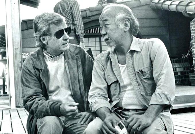 "John G. Avildsen directing Pat Morita on the set of ""The Karate Kid Part II"" (1986)"