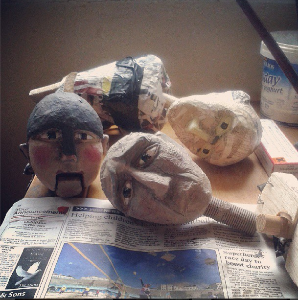 Puppet heads being painted