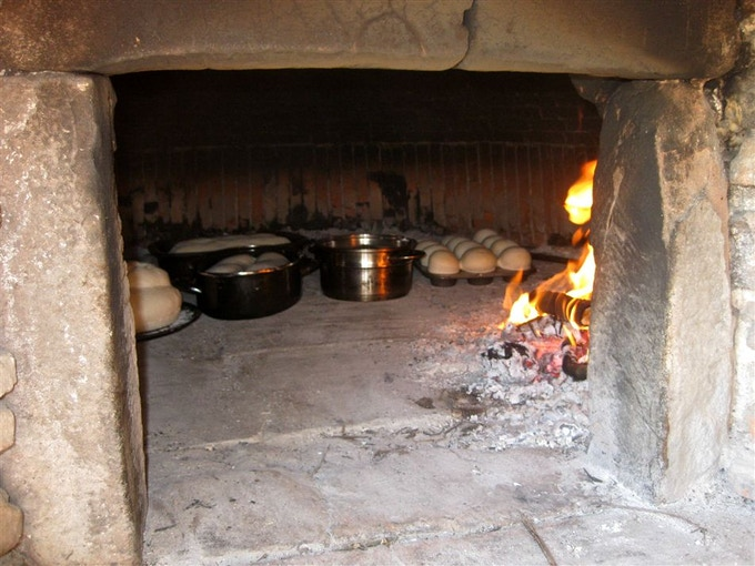 Baking our home made bread in the farms 300 year old oven