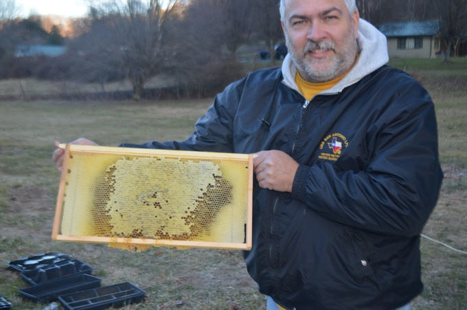 Me and a partially filled frame of honey.